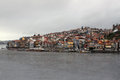 Porto under dark sky view of cityscape along douro river portugal cloudy Royalty Free Stock Photo