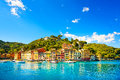 Portofino luxury village landmark panorama view liguria italy and yacht in little bay harbor Royalty Free Stock Images