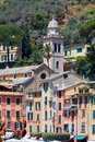 Portofino village with colorful houses and Divo Martino church Royalty Free Stock Photo