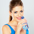 Portrait of active woman drinking mineral water of bottle Royalty Free Stock Photo