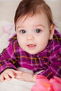 Portrait adorable baby girl looking at camera Stock Photos