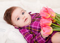 Portrait adorable baby girl with spring flowers Stock Image