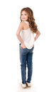 Portrait of adorable happy little girl in jeans Royalty Free Stock Photo
