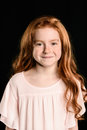 Portrait of adorable little redhead girl smiling at camera Royalty Free Stock Photo
