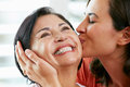 Portrait Of Adult Daughter Kissing Mother Royalty Free Stock Photos