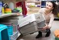 Portrait of adult woman purchasing pet kennels