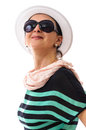 Portrait of adult woman with white hat beautiful smiling and black sunglasses studio shoot isolated on background Royalty Free Stock Images
