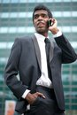 Portrait of a african american businessman on the phone outdoors talking Royalty Free Stock Images