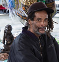 Portrait of african american man at flea market with dreadlocks Royalty Free Stock Photography