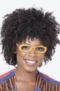 Portrait of an african american woman wearing glasses over gray background Stock Image
