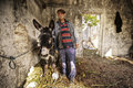 Portrait of an agriculture worker with his donkey Royalty Free Stock Photos