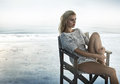 Portrait of an alluring woman sitting on the retro chair Royalty Free Stock Photo