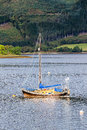 Portrait of an anchored sailboat at Glencoe Royalty Free Stock Photo