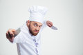 Portrait of angry chef cook holding knifes Royalty Free Stock Photo