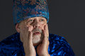 Portrait of anxious senior man in blue oriental clothes Royalty Free Stock Photo