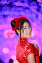 Portrait asian beautiful girl in chinese traditional red dress smile colorful night light Royalty Free Stock Photo