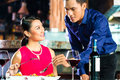 Portrait of asian couple in restaurant eating Royalty Free Stock Image