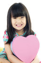 Portrait of asian cute child with pink box heart Royalty Free Stock Photos