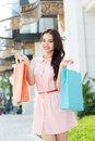 Portrait asian girl doing shopping outdoors Royalty Free Stock Images