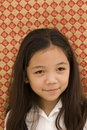 Portrait of Asian Girl with Mischievious Look Royalty Free Stock Photo