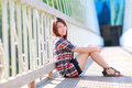 Portrait of the asian girl 20 years old posing outdoors wear plaid shirt Royalty Free Stock Photo