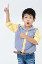 Portrait of asian happy boy pointing away and looking at camera Royalty Free Stock Photo