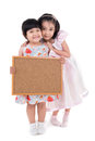 Portrait of Asian little girl hold wood board on white background Royalty Free Stock Photo