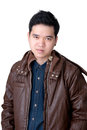 Portrait of asian man wearing jeans shirt amd jacket and leather close up shot on white background Stock Photo