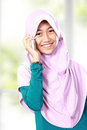 Portrait of an asian muslim kid talking on the cell phone at home Royalty Free Stock Photos