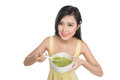 Portrait of asian woman eating/holding a plate of green vegetabl Royalty Free Stock Photo