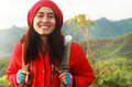 Portrait asian young woman hiking traveller backpacker during trip smiling look on you camera spring season Royalty Free Stock Photos