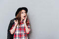 Portrait of an astonished amazed girl in plaid shirt