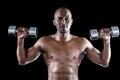 Portrait of athlete lifting dumbbell while exercising Royalty Free Stock Photo