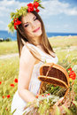 Portrait of an attractive beautiful girl in a poppy field Royalty Free Stock Photo