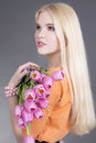 Portrait of attractive blondie girl with tulips Royalty Free Stock Photography