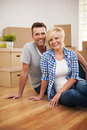 Portrait of attractive couple in new house Stock Images