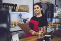 Portrait of attractive female barista working in cafeteria Royalty Free Stock Photo