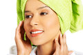Portrait of attractive smiling woman wrapped in towel with turba