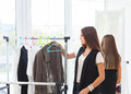 Portrait of attractive teen girl making choices clothes Royalty Free Stock Photo