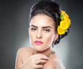 Portrait of a attractive woman with beautiful eyes and flowers in her hair hairstyle make up female art yellow roses elegance Stock Photography