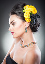 Portrait of a attractive woman with beautiful eyes and flowers in her hair hairstyle make up female art yellow roses elegance Stock Photos