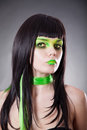 Portrait of attractive woman with green make-up Stock Photo
