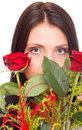 Portrait of attractive woman holding red rose Stock Photo