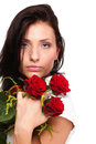 Portrait of attractive woman holding a red rose Stock Photo