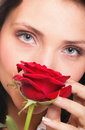 Portrait of attractive woman holding a red rose Stock Image