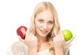 Portrait attractive woman holding two apples isolated Royalty Free Stock Images