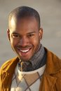 Portrait of an attractive young african american man smiling outdoors close up Stock Photos