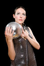 Portrait attractive young brunette mirror ball her hands isolated black Stock Photos