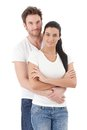 Portrait of attractive young couple smiling hugging each other Stock Image