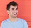 Portrait of an attractive young man laughing outdoors close up Royalty Free Stock Photos